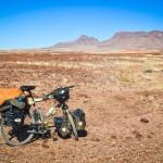 Bike loaded in the surreal landscape of Brandberg West