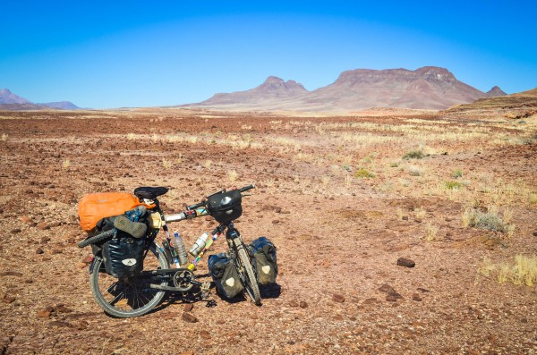 Bike loaded in the surreal landscape of Brandberg West